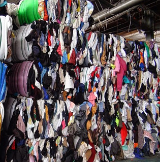 Recycling of fabric waste